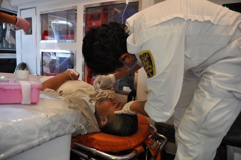 . An emergency worker treats an injured worker of Mexico\'s state-owned oil company PEMEX after an explosion at an adjacent building to the executive tower of PEMEX in Mexico City, Thursday Jan. 31, 2013.    (AP Photo/Guillermo Gutierrez)