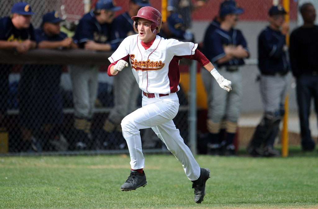 . La Canada\'s George Steckbeck scores on a bases loaded double by Daniel del Valle (not pictured) in the fourth inning of a CIF-SS playoff baseball game against California at La Canada High School on Thursday, May 16, 2013 in La Canada, Calif. La Canada won 4-2.  (Keith Birmingham Pasadena Star-News)