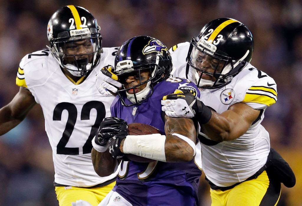 . Baltimore Ravens wide receiver Steve Smith (89) is tackled by Pittsburgh Steelers cornerback William Gay (22) and free safety Mike Mitchell (23) during the second half of an NFL football game Thursday, Sept. 11, 2014, in Baltimore. (AP Photo/Patrick Semansky)