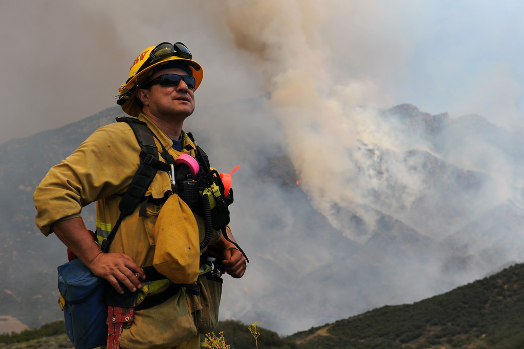 . Monrovia firefighter Ernie Moreno watches an air attack in Ventura County, Friday, May 3, 2013. (Michael Owen Baker/Staff Photographer)