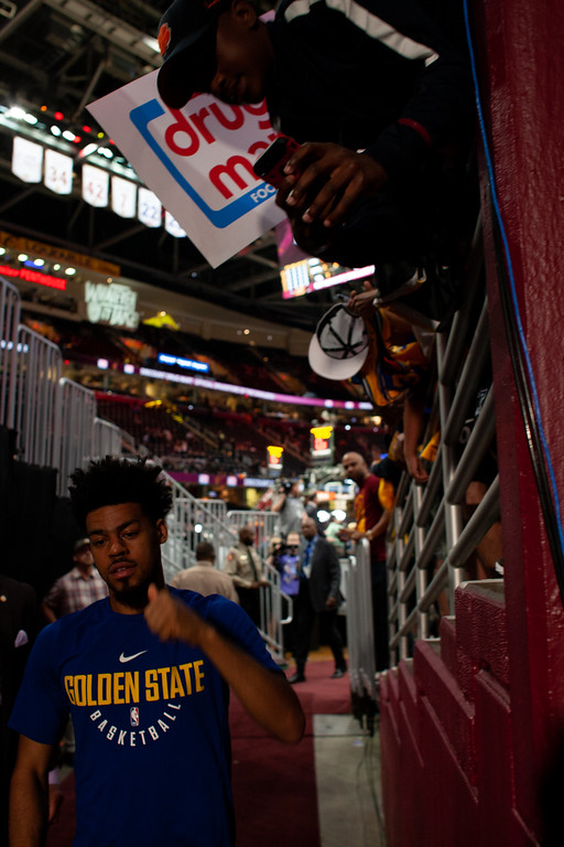 . A fan takes a photo with Warriors\' guard Quinn Cook prior to game 3 of the NBA Finals on June 6, 2018.  Michael Johnson/ The News Herald