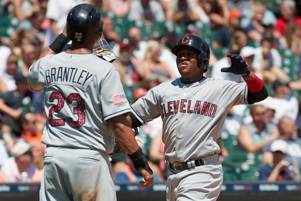 . Cleveland Indians\' Jose Ramirez, right, is congratulated by Michael Brantley (23) after hitting a three-run home run against the Detroit Tigers in the fourth inning of a baseball game in Detroit, Sunday, July 2, 2017. (AP Photo/Rick Osentoski)
