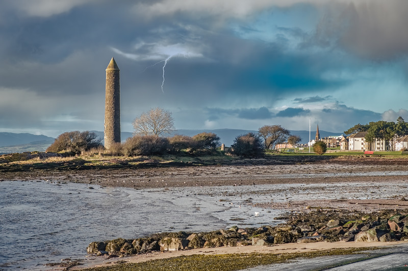 Largs Foreshore and the Pencil Monument and a Small Bolt of Lightning as a storm Comes Over.