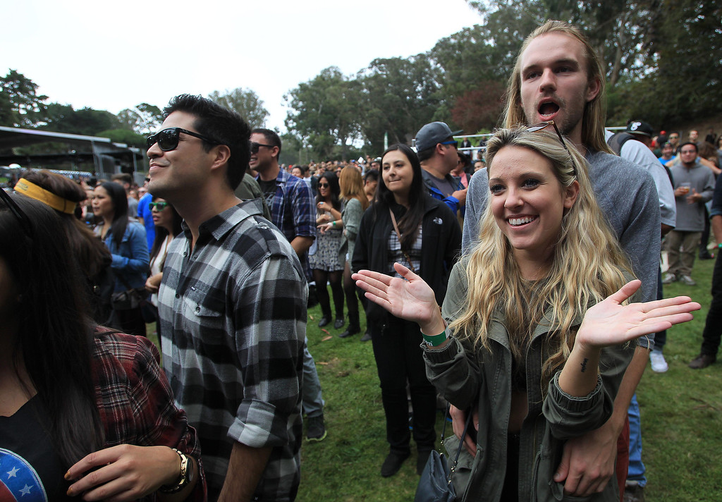 . Lisa Dixon, of Santa Monica, and Jeff Cope, of San Francisco, right, listen to Jessie Ware\'s set at the Sutro stage during the 6th annual Outside Lands Music and Arts Festival in Golden Gate Park in San Francisco, Calif., on Friday, Aug. 9, 2013.  (Jane Tyska/Bay Area News Group)
