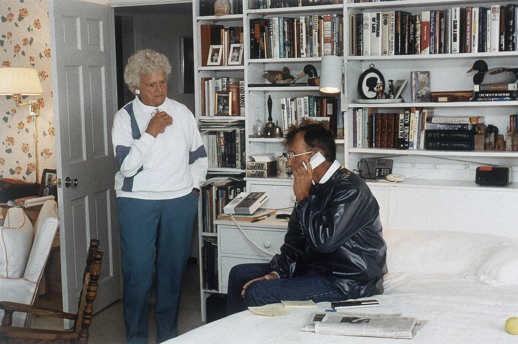 . President George H.W. Bush, right, with first lady Barbara Bush, left, is seen at his home talking on the phone with Soviet leader Mikhail Gorbachev from Walkers Point, Kennebunkport, Maine, Aug. 21, 1991. The attempted coup of the Soviet government appears to have failed and Gorbachev will be returning to Moscow. (AP Photo/White House/Susan Biddle)