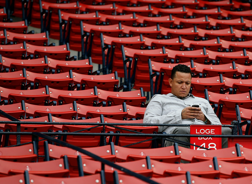 . Detroit Tigers\' Miguel Cabrera sits in the Fenway Park stands before Game 6 of the American League baseball championship series against the Boston Red Sox on Saturday, Oct. 19, 2013, in Boston. (AP Photo/Elise Amendola)