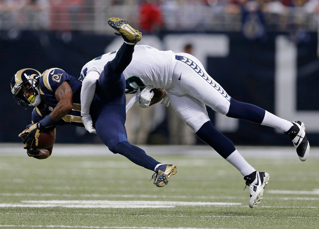 . St. Louis Rams wide receiver Tavon Austin (11) gets tackled by Seattle Seahawks cornerback Brandon Browner (39) during the first half of an NFL football game, Monday, Oct. 28, 2013, in St. Louis. (AP Photo/Michael Conroy)