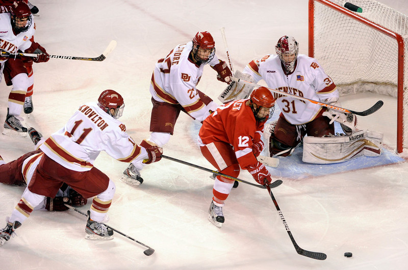 . Cornell center John Knisley (12) looked for a shot in the third period. The University of Denver hockey team defeated Cornell 2-1 at Magness Arena Saturday night, January 5, 2013. Karl Gehring/The Denver Post