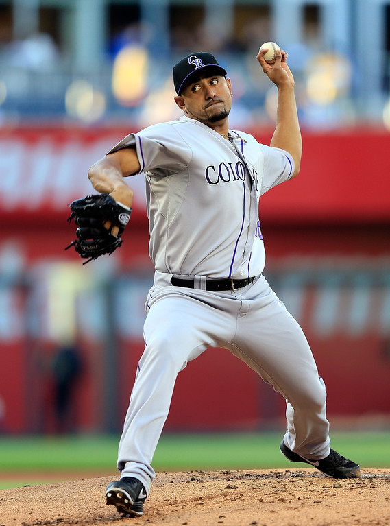 . Starting pitcher Franklin Morales #56 of the Colorado Rockies warms up just prior to the start of the game against the Kansas City Royals at Kauffman Stadium on May 13, 2014 in Kansas City, Missouri.  (Photo by Jamie Squire/Getty Images)