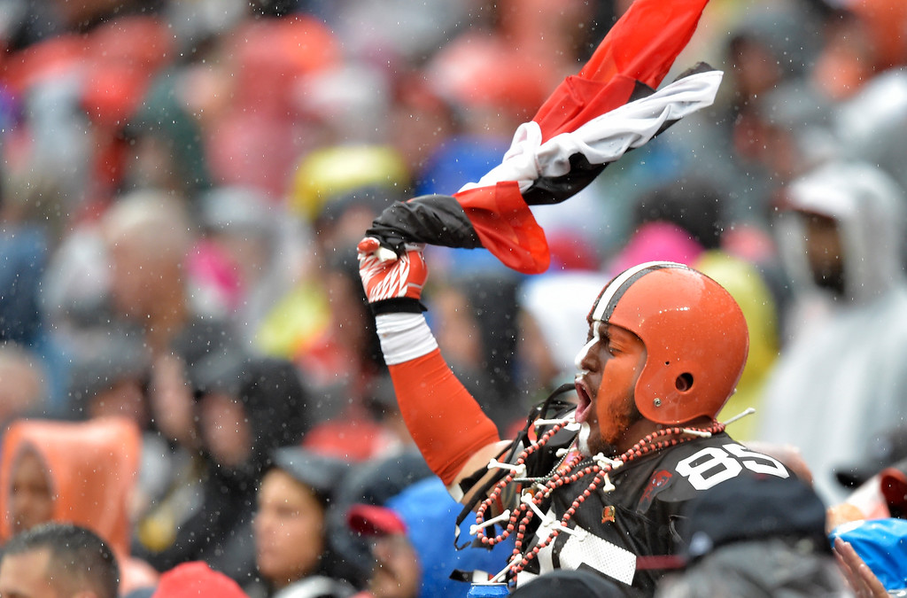 . A Cleveland Browns fan cheers during the first half of an NFL football game against the Pittsburgh Steelers, Sunday, Sept. 9, 2018, in Cleveland. (AP Photo/David Richard)