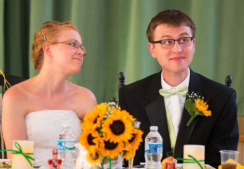 Bride and Groom candid at table listening to speeches.jpg
