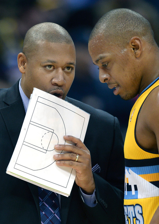. DENVER, CO. - JANUARY 03:  Denver assistant coach Melvin Hunt had a word with Randy Foye in the second half. The Denver Nuggets broke an eight-game losing streak with a 111-108 win over the Memphis Grizzlies at the Pepsi Center Friday night, January 3, 2014. Photo By Karl Gehring/The Denver Post