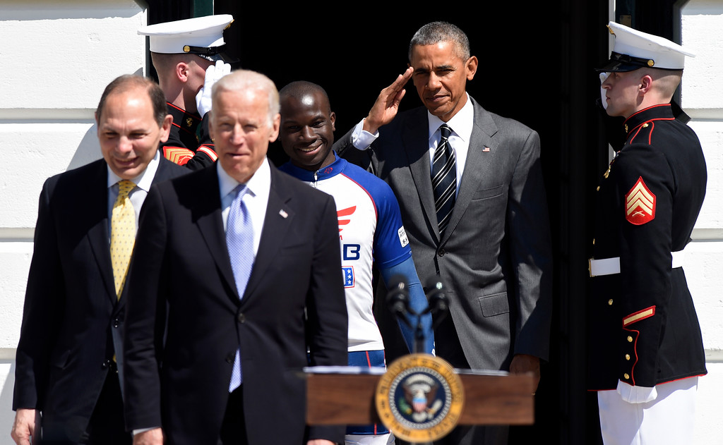 . President Barack Obama salutes as he walks onto the South Lawn of the White House in Washington, Thursday, April 14, 2016, with Ret. Army Capt. William Reynolds, Vice President Joe Biden and Veterans Affairs Secretary Robert McDonald for the start of the Wounded Warrior Ride. The ride is to raise awareness of our nation\'s heroes who battle the physical and psychological damages of war. (AP Photo/Susan Walsh)