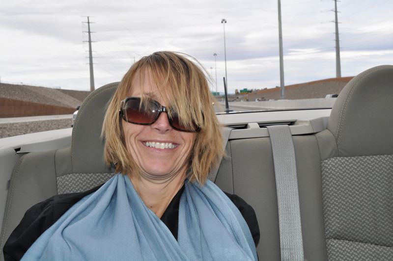 A little windblown in the back of the convertible.....