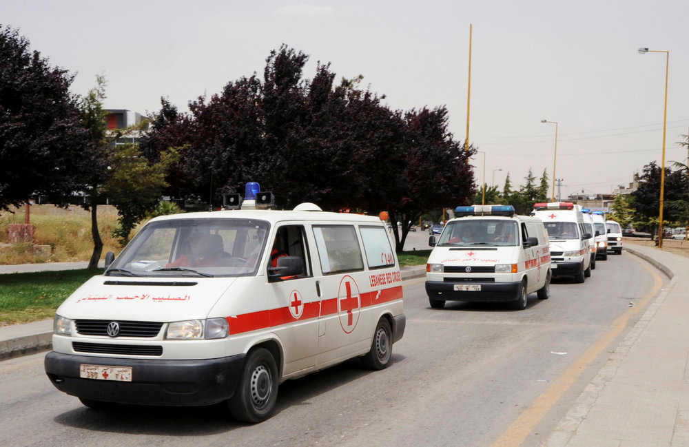 . Lebanese Red Cross ambulances transporting Syrian refugees injured in the fighting between Syrian government troops and rebel fighters in the Syrian border town of Qusair, travel to a hospital in Jib-Janine town, Bekaa Valley June 8, 2013. REUTERS/Stringer