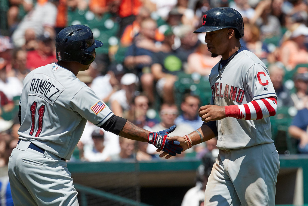 . Cleveland Indians Francisco Lindor, right, receives congratulations from Jose Ramirez, left, after scoring against the Detroit Tigers in the fourth inning of a baseball game in Detroit, Sunday, July 2, 2017. (AP Photo/Rick Osentoski)