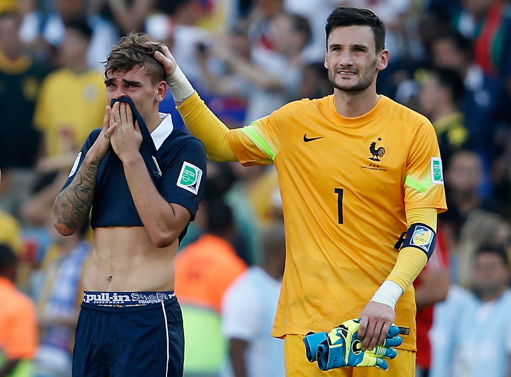 . France\'s forward Antoine Griezmann (L) and France\'s goalkeeper and captain Hugo Lloris react after losing the quarter-final football match between France and Germany 1-0 at the Maracana Stadium in Rio de Janeiro during the 2014 FIFA World Cup on July 4, 2014. (ADRIAN DENNIS/AFP/Getty Images)