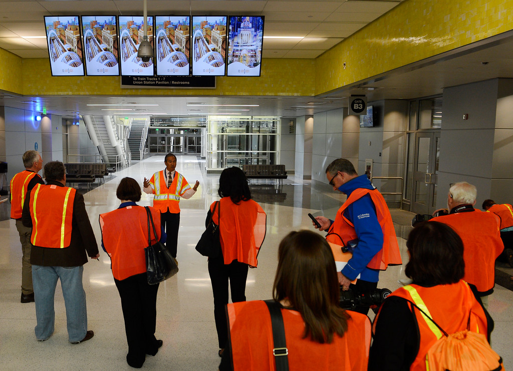 . DENVER, CO. - APRIL 25: Jerome Nery, center, RTD project manager for Denver Union Station, talks to journalists at the Underground Bus Concourse at the Union Station Transit Center during a media tour Friday morning, April 25, 2014. The transit center is scheduled to open May 11, 2014. (Photo By Andy Cross / The Denver Post)