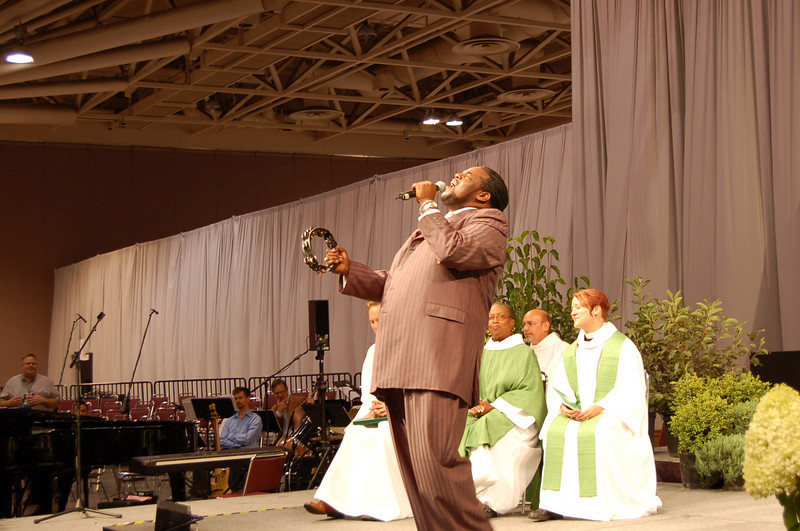 Roosevelt Credit, professional African American singer from New York City, brought down the house with his uplifting Gospel music.