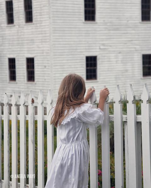 girl_white_fence_house-tall.jpg