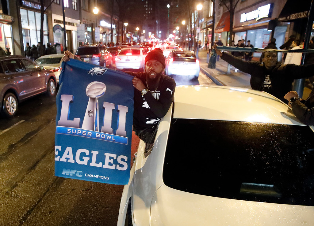 . Philadelphia Eagles fans celebrate the team\'s victory in the NFL Super Bowl 52 between the Philadelphia Eagles and the New England Patriots, Sunday, Feb. 4, 2018, in downtown Philadelphia. (AP Photo/Matt Rourke)