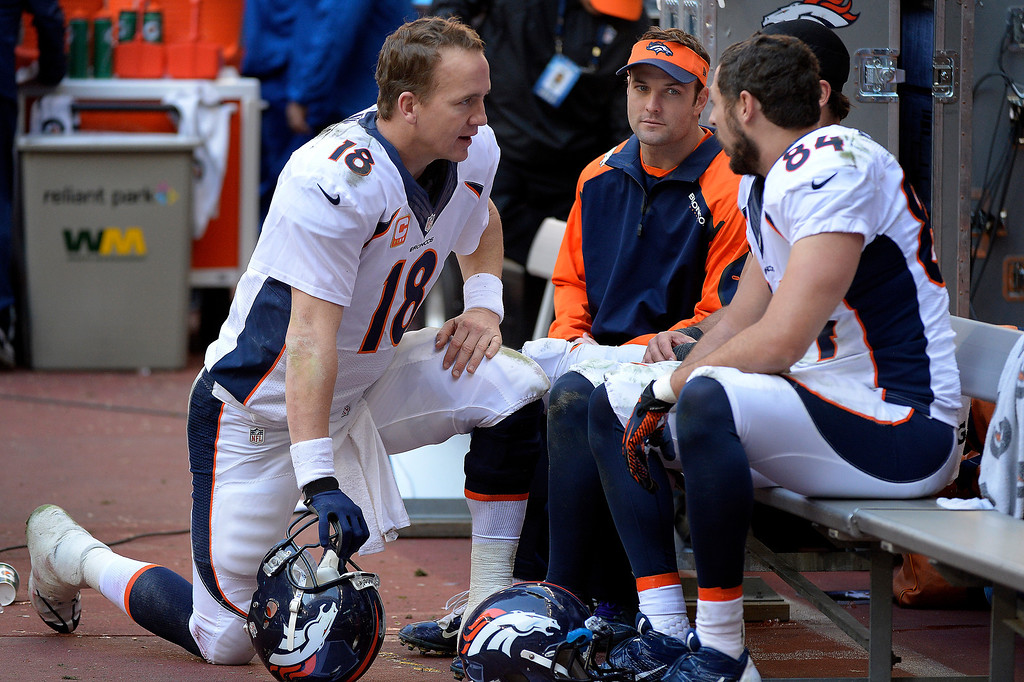. Denver Broncos quarterback Peyton Manning #18 talks to wide receiver Wes Welker #83, wide receiver Eric Decker #87 and tight end Jacob Tamme #84 in the second half against the Houston Texans at Reliant Stadium December 22, 2013 Houston, Texas. (Photo By Joe Amon/The Denver Post)