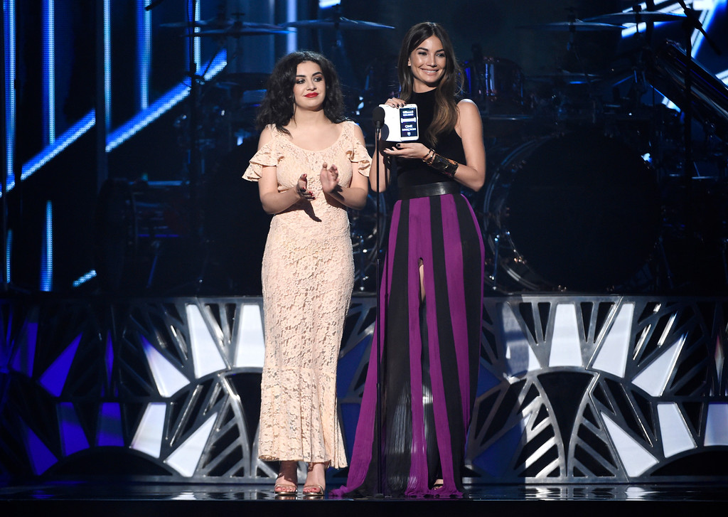 . Charli XCX, left, and Lily Aldridge present the award for top duo/group at the Billboard Music Awards at the MGM Grand Garden Arena on Sunday, May 17, 2015, in Las Vegas. (Photo by Chris Pizzello/Invision/AP)