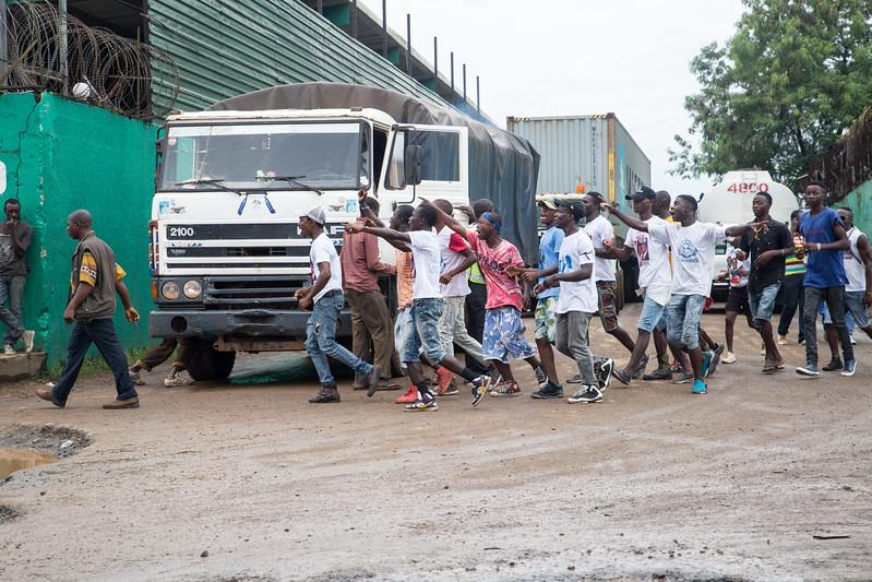 Monrovia, Liberia October 6, 2017 - Supporters run through traffic in Monrovia.