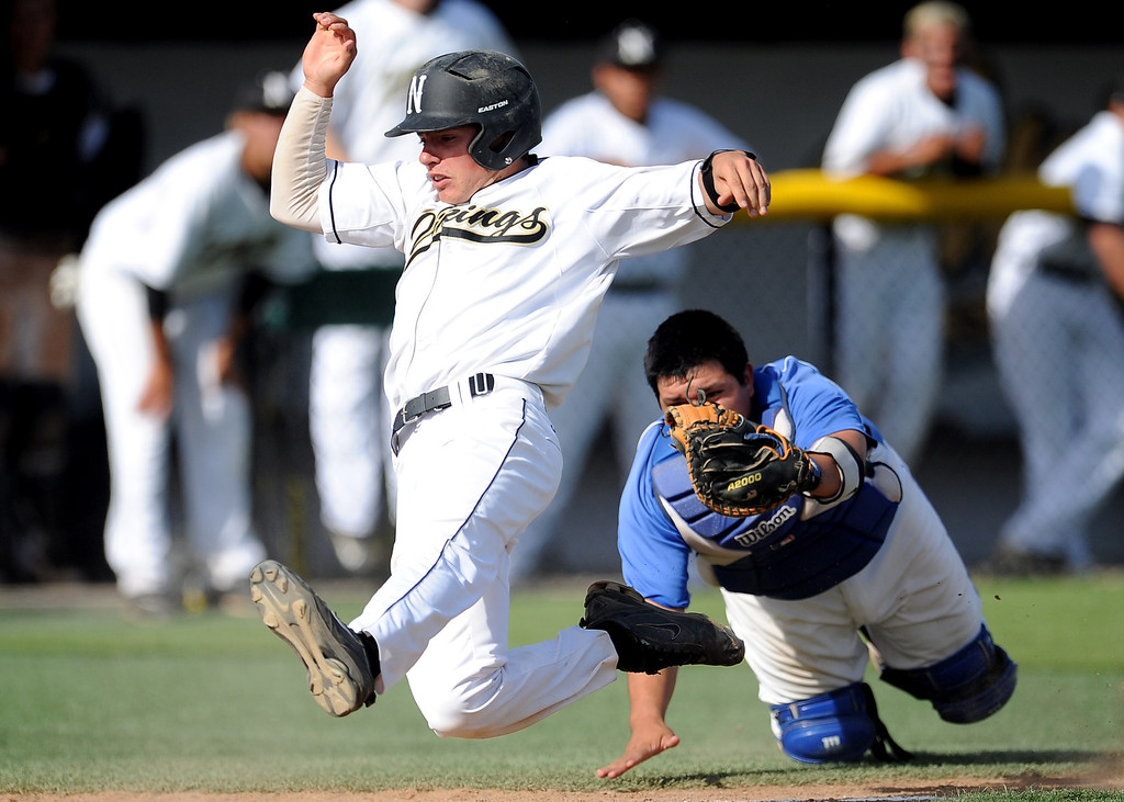 . Northview\'s Brian Centeno scores past the tag by Baldwin Park catcher Daniel Escobedo on a single by Kollby Oriti (not pictured) in the fourth inning of a prep baseball game at Northview High School on Tuesday, April 23, 2012 in Covina, Calif. Northview won 8-2.    (Keith Birmingham/Pasadena Star-News)
