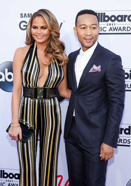. Chrissy Teigen, left, and John Legend arrive at the Billboard Music Awards at the MGM Grand Garden Arena on Sunday, May 17, 2015, in Las Vegas. (Photo by Eric Jamison/Invision/AP)