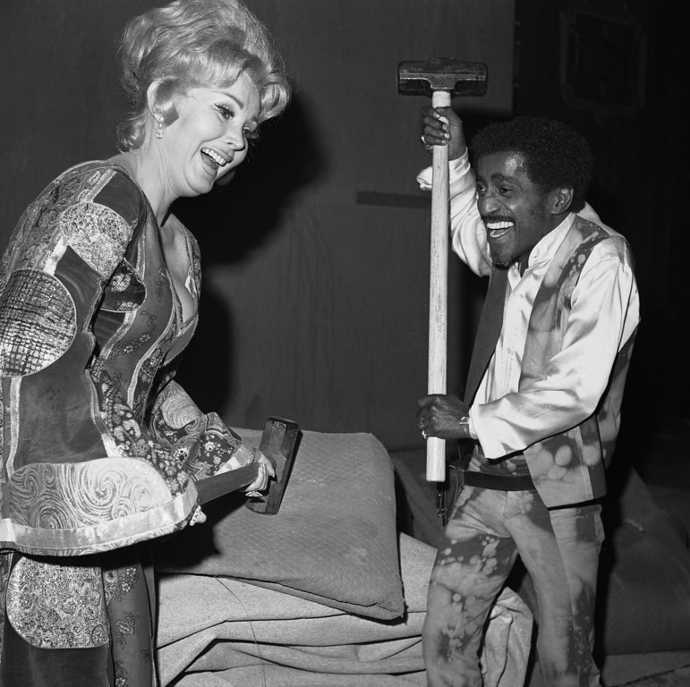 . Zsa Zsa Gabor has a bit of trouble getting her sledgehammer into position, but Sammy Davis Jr. is ready to start demolition of the famous Coconut Grove nightclub in Los Angeles, on February 25, 1970.        (AP Photo/Harry Matosian)