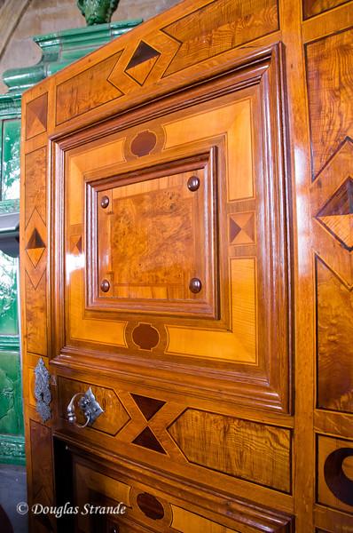 Intricate inlaid wooden door at Prague Castle