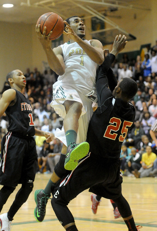 . 02-26-2012--(LANG Staff Photo by Sean Hiller)-Roschon Prince(1) battles Etiwanda\'s Delewis Johnson (25) in Tuesday\'s CIF Southern Section Division 1AA semifinal boys basketball game at Long Beach Poly High School. Etiwanda beat Poly the 59-55.