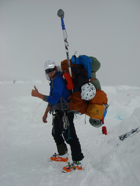 July 8th (Day #16). Moved to C3 (14,200ft = 4.328m) by 6pm in ~3hrs. At C3 picked up more left gear. 4 of us - skiers, were hevily loaded - here is Tim for example. Our guides had sleds.