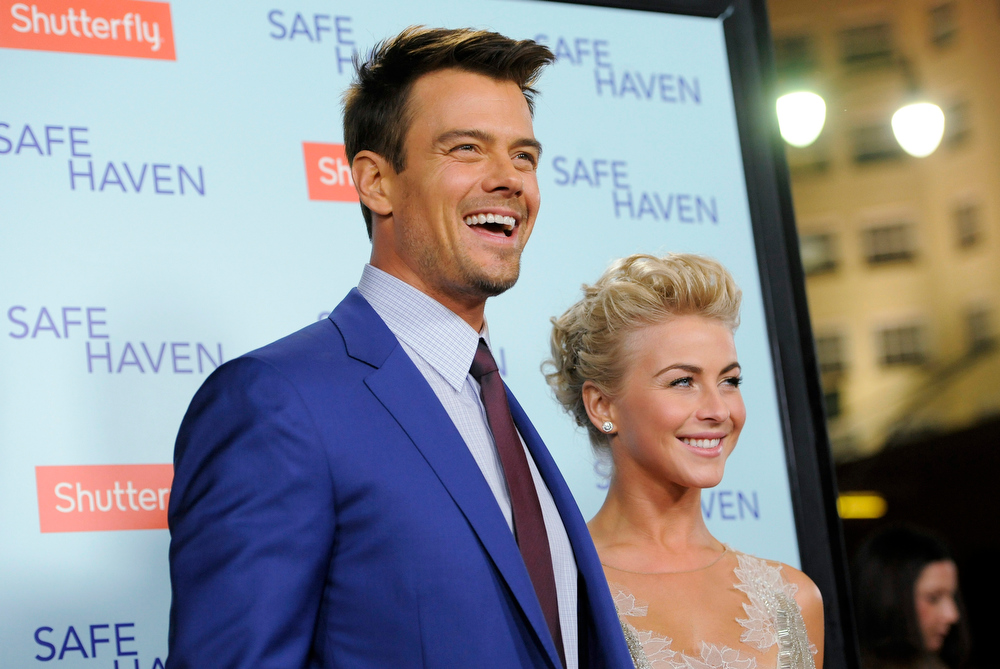 ". Josh Duhamel, left, and Julianne Hough, cast members in ""Safe Haven,\"" pose together at the U.S. premiere of the film on Tuesday, Feb. 5, 2013 in the Hollywood section of Los Angeles. (Photo by Chris Pizzello/Invision/AP)"