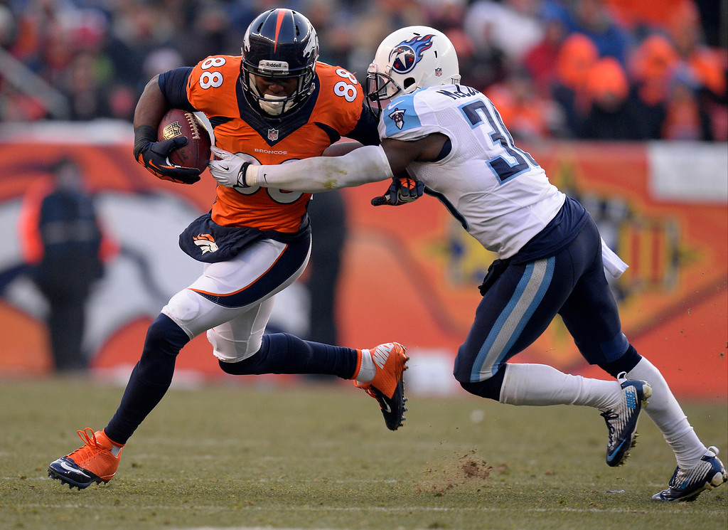 . Denver Broncos wide receiver Demaryius Thomas (88) tries to outrun Tennessee Titans cornerback Jason McCourty (30) in the second quarter. (Photo by John Leyba/The Denver Post)