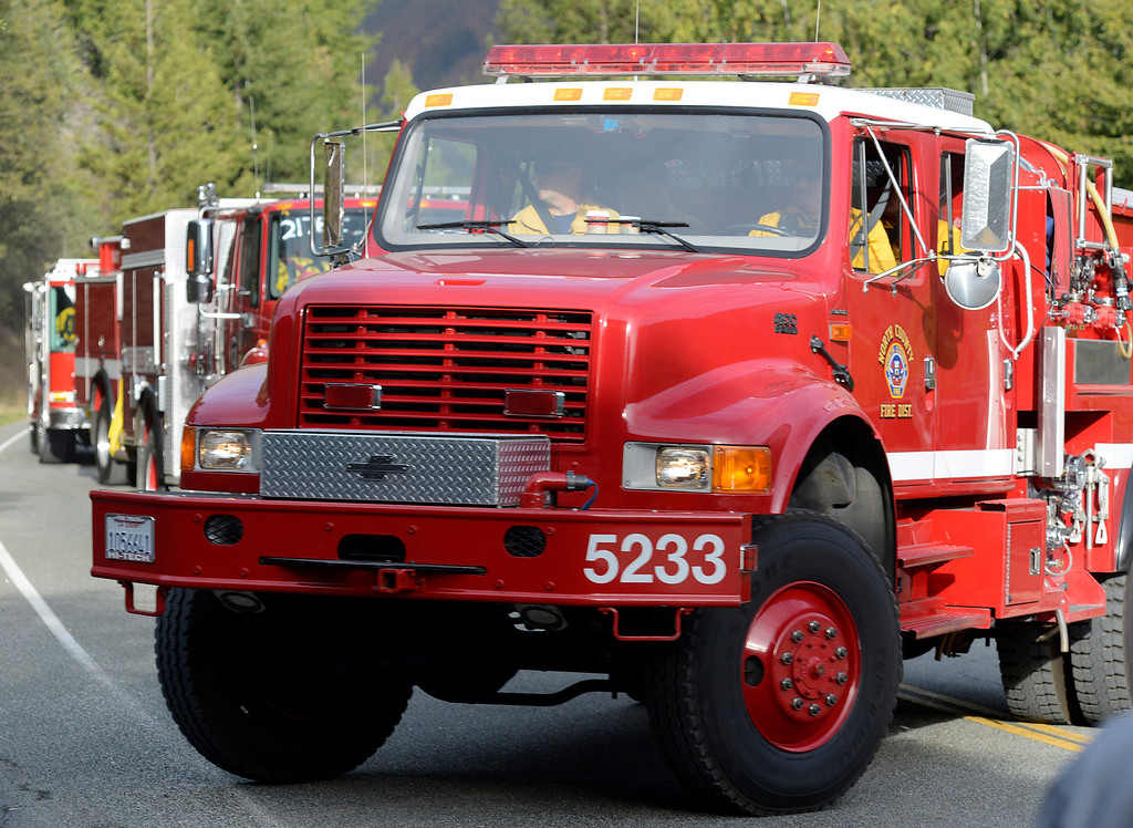 . Fire trucks turn up Pfeiffer Ridge Road as firefighters battle a wildland fire in the Pfeiffer Ridge area in Big Sur, Calif. on Monday December 16, 2013. (Photo David Royal/ Monterey County Herald)