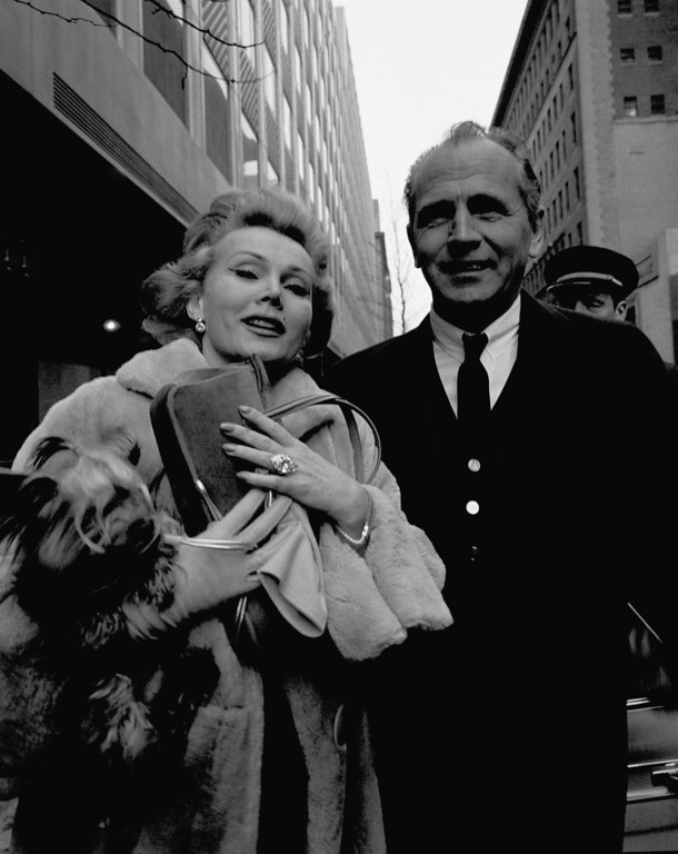 ". Zsa Zsa Gabor holds her left hand up for all to see the large diamond ring she\'s now wearing. Standing beside Zsa Zsa is wealthy builder Hal B. Hayes, whom Miss Gabor says she\'ll wed ""in about three months.\""    She\'s been married three times previously.  They\'re both standing outside the 21 Club  restaurant on Jan. 13, 1959 in New York, after having lunch there.   Hayes, who is from Beverly Hills, California.   (AP Photo/Robert Wands)"
