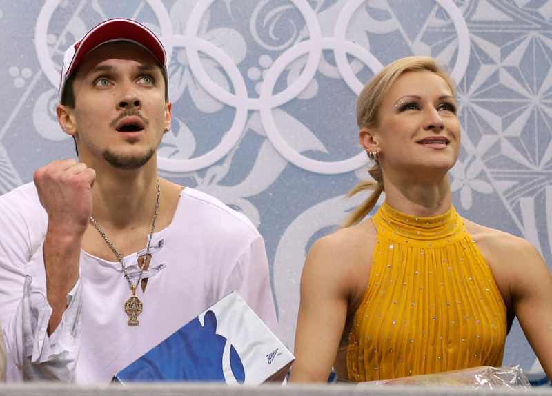 . Tatiana Volosozhar and Maxim Trankov of Russia wait in the results area after competing in the pairs free skate figure skating competition at the Iceberg Skating Palace during the 2014 Winter Olympics, Wednesday, Feb. 12, 2014, in Sochi, Russia. (AP Photo/Darron Cummings)