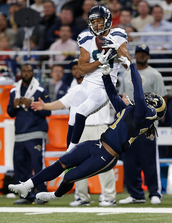 . Seattle Seahawks wide receiver Golden Tate (81) makes a catch against St. Louis Rams cornerback Janoris Jenkins (21) during the second half of an NFL football game, Monday, Oct. 28, 2013, in St. Louis. Tate ran the ball into the end zone for a touchdown. (AP Photo/Michael Conroy)
