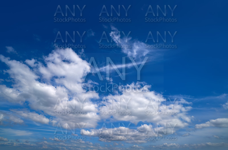 Blue sky white summer cumulus clouds