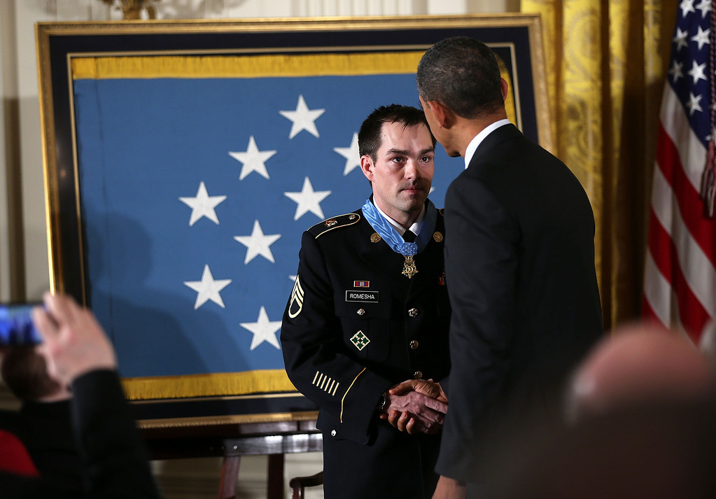 . U.S. President Barack Obama (R) shakes hands with Clinton Romesha (L), a former active duty Army Staff Sergeant, after he presented him with the Medal of Honor for conspicuous gallantry at the White House February 11, 2013 in Washington, DC.  (Photo by Alex Wong/Getty Images)