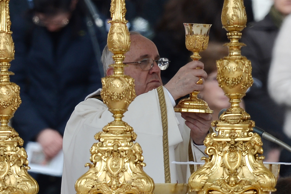 . Pope Francis holds a calice during his inauguration mass at St Peter\'s square on March 19, 2013 at the Vatican. World leaders flew in for Pope Francis\'s inauguration mass in St Peter\'s Square on Tuesday where Latin America\'s first pontiff will receive the formal symbols of papal power.  FILIPPO MONTEFORTE/AFP/Getty Images