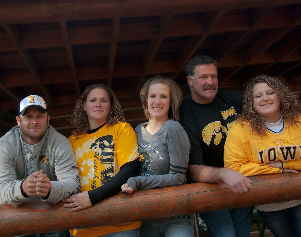 Alsesha scheduled this October family portrait session for her family of Iowa Hawk Eye Football fans.  October 2011, Ft Defiance State Park near Estherville, Iowa.