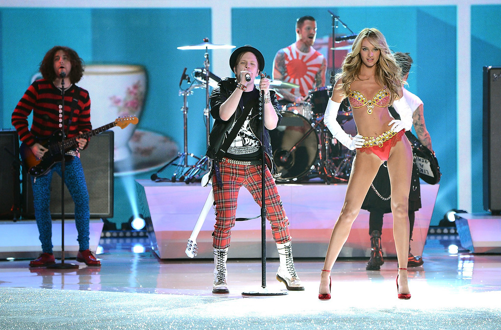 . Fall Out Boy perform while model Candice Swanepoel walks the runway wearing the $10 million Royal Fantasy Bra during the 2013 Victoria\'s Secret Fashion Show at the 69th Regiment Armory on Wednesday, Nov. 13, 2013 in New York. (Photo by Evan Agostini/Invision/AP)