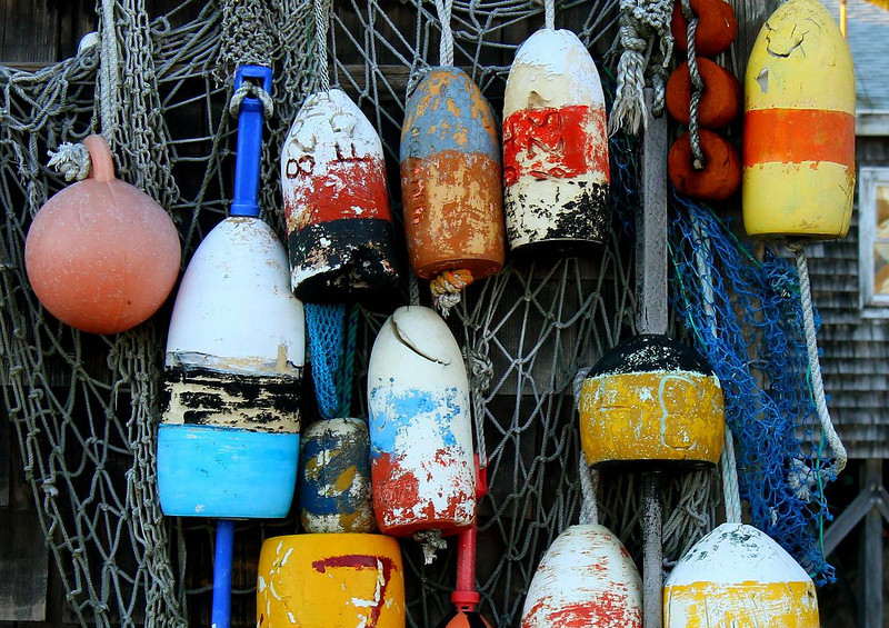Old Lobster trap buoys. Though antique and outdated, the retired ones serve as decoration for many restaurants and structures in port towns of New England.