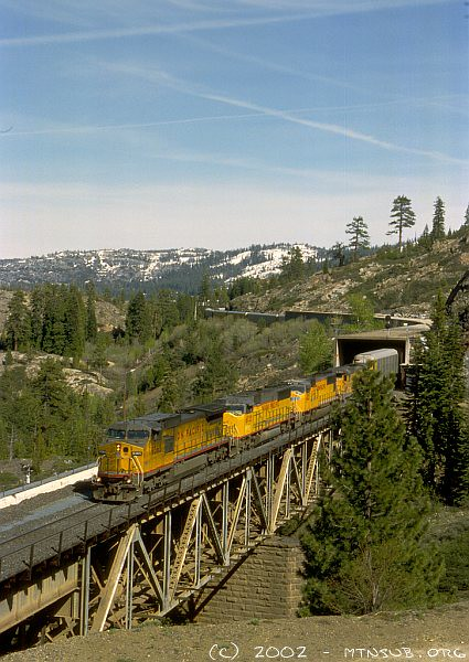 "A westbound autorack train decends ""The Hill"" as it crosses Butte Canon Bridge on the single track between Cisco and Emigrant Gap."