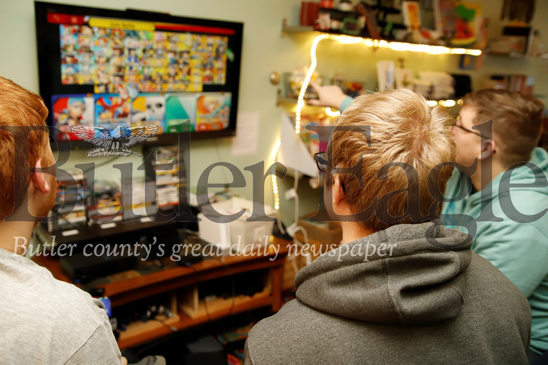 Aaron Bennett (left), Stephen Matousek and Ryan Kish choose their characters for a round of Smash Brothers at Parents in Toto's community center game day Saturday. The Zelienople-based non-profit offers a community center and resources for teens and young adults with Autism and their families. Seb Foltz/Butler
