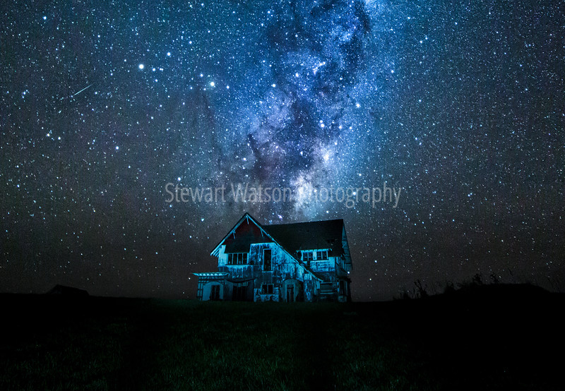 The milky way with the centre of the Galatic Core directly above the abandoned, derelect house at Ahiaruhe near Carterton NZ. A shooting star zips past as well.