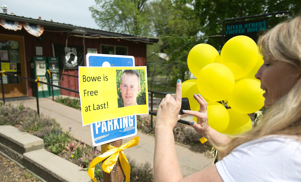 . Diane Walker takes a picture of a sign celebrating U.S. Army Sgt. Bowe Bergdahl\'s release in front of Zaney\'s coffee shop in Hailey, Idaho. Bergdahl, 28, had been held prisoner by the Taliban since June 30, 2009. He was handed over to U.S. special forces by the Taliban in exchange for the release of five Afghan detainees held by the United States. (AP Photo/The Idaho Statesman, Kyle Green)